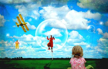Creative Photo of Little Girl Looking at Man in Bubble Against Blue Sky